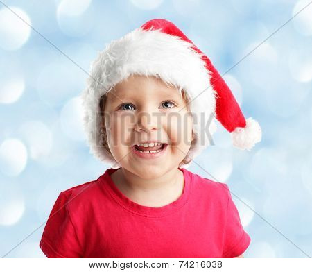 Child in a Christmas hat looking up