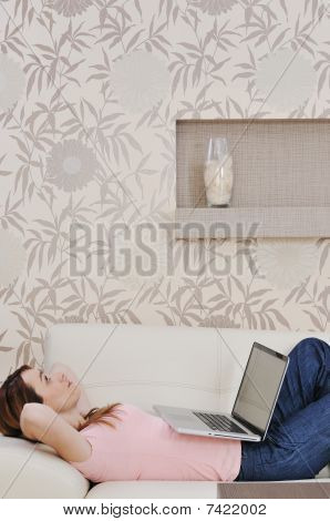 Woman Relaxing And Working At Home