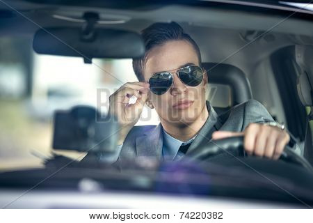 business man with sunglasses  driving a car