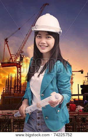 Female Engineer With Construction Plant Against Building Stucture Site Plant