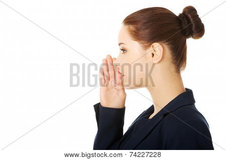 Young business woman talking gossip