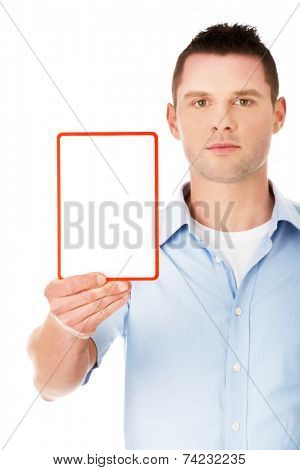 Happy young man showing and displaying placard with copy space