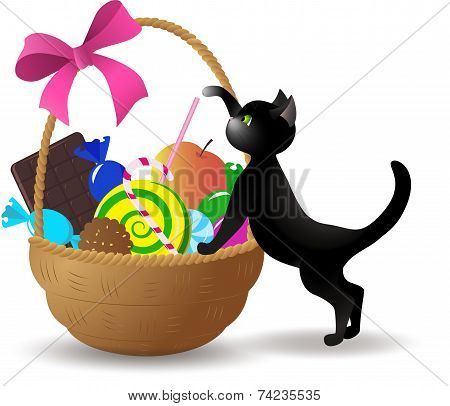 The Kitten Next To The Basket Of Sweets