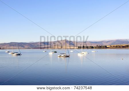 Yachts Moored In A Tranquil Setting On The Midmar Dam