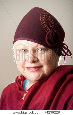 White-haired Woman In Maroon Hat And Shawl