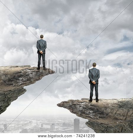 Rear view of businessman standing at rock edge