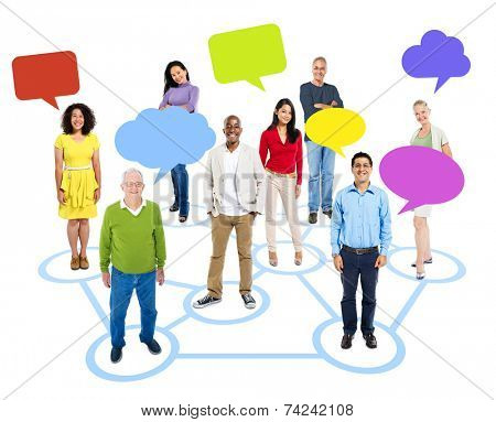 Cheerful Multi-Ethnic Group Of People Standing Individually In A Circle Which Connects To Others With Empty Multi-Colored Speech Bubbles Above.