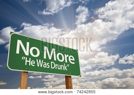 No More - He Was Drunk Green Road Sign with Dramatic Clouds and Sky.