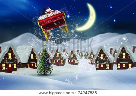 Santa flying his sleigh against cute christmas village at night