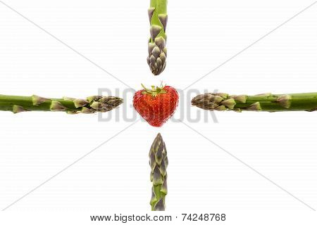 Four Asparagus Spears And One Strawberry