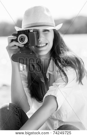 Young Pretty Woman Taking A Photography At The Beach.