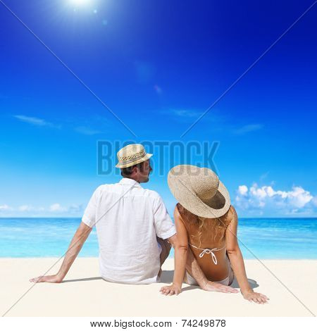 Couple relaxing on the beach.