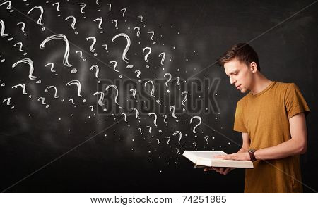Confused man reading a book with question marks coming out from it