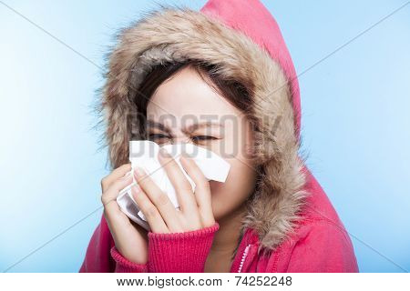Young Woman Catch A Cold And Sneezing Nose With A Sweater. Isolated On Gray Background