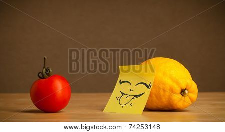 Lemon with sticky post-it note gesturing with tongue to tomato