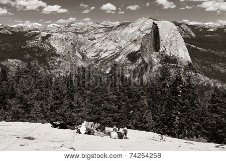 Hiker take a rest at Half Dome in Yosemite National Park.