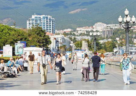 Tourists Walk On Promenade In Yalta In September