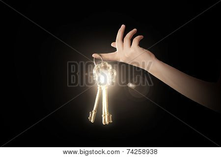 Close up of woman hand holding golden key