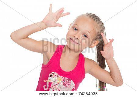 Joyful girl plays with his hands. Girl six years.