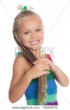 Playful girl holding her dreadlocks. Girl is six years old.
