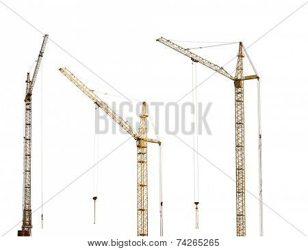 three yellow hoisting cranes isolate on white background