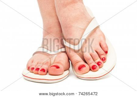 female foot in thongs on a white background