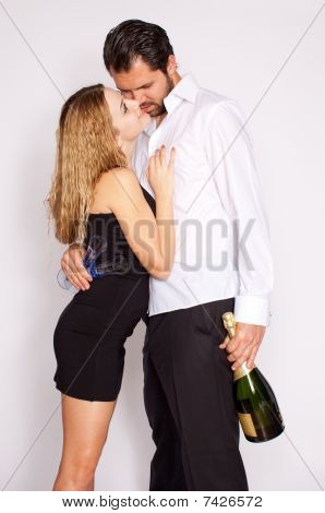Happy Young Couple With Champagner