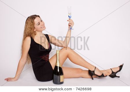 Happy Young Woman With Champagner