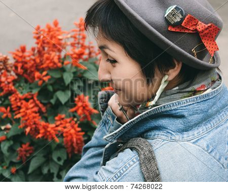 Close up Pretty Smiling Woman Wearing Gray Hat and Denim Jacket Fashion in Side View. Captured Outdoor.