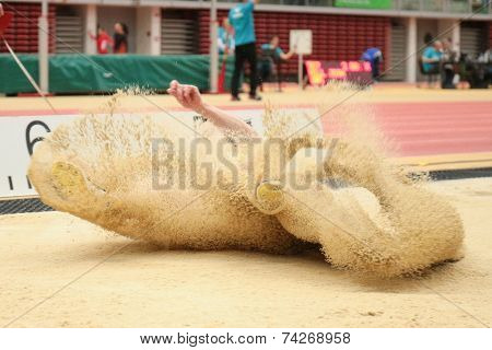 LINZ, AUSTRIA - JANUARY 30, 2014: Katarina Libalova (#606 Czech Republic) places 7th in the long jump team event in an indoor track and field meeting.