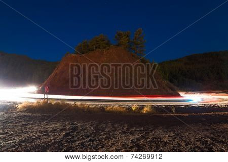 Car Lights When Driving In The Mountains