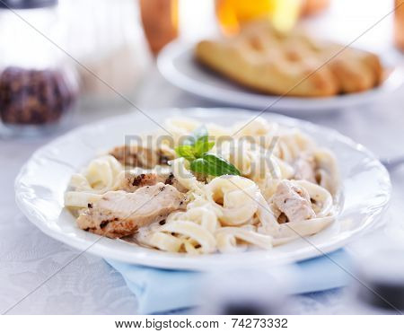 italian fettuccine alfredo pasta with grilled chicken dinner