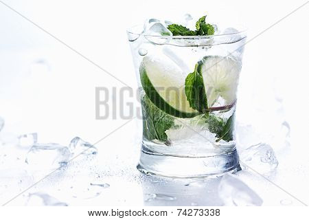 mojito cocktails on white background with chunks of ice