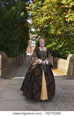 Tall lady in a medieval costume.