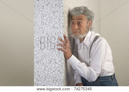 Old Man Put His Hand On The Wall