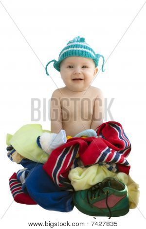 The Baby In A Knitted Cap Sits