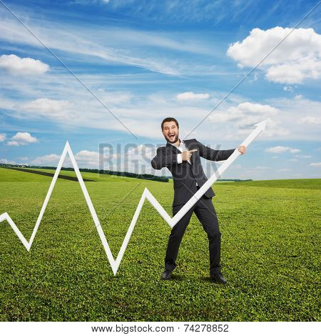 excited businessman pointing at white pointer and laughing. photo at outdoor