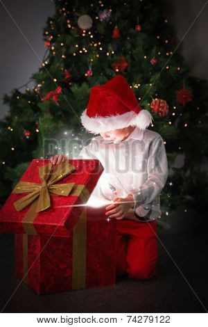 Composite image of Child opening his christmas present against snow