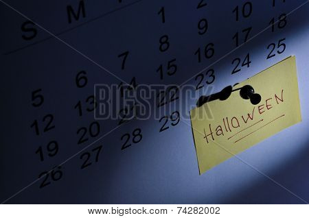 October Calendar Showing The Halloween Prominently With A Note