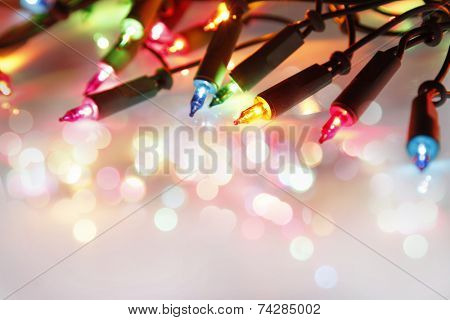 Closeup of Christmas lights glowing