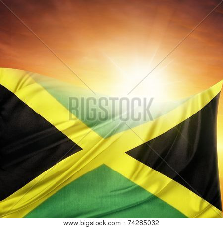 Jamaican flag in front of bright sky
