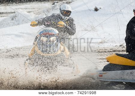 Snowmobile moves on bend of sport track