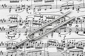 stock photo of tuning fork  - Pitchfork on sheet music  - JPG