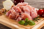 stock photo of turkey-hen  - Raw turkey meat on cutting board on wooden background - JPG
