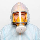 foto of respiration  - Man in protective clothing with respirator - JPG