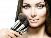 image of makeover  - Beauty Girl with Makeup Brushes - JPG