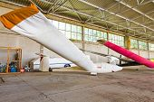 picture of glider  - Covered gliders are resting in hangar due to the off duty - JPG
