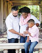 stock photo of gazebo  - A biracial family acknowledging the unborn in the pregnant mom - JPG