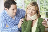 pic of neck brace  - Husband Comforting Wife Suffering With Neck Injury - JPG