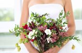 picture of bouquet  - Unusual wedding bouquet with succulent flowers in retro style at hands of a bride - JPG